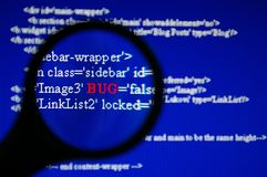 Bug Tracking. With magnifier on LCD screen Royalty Free Stock Image