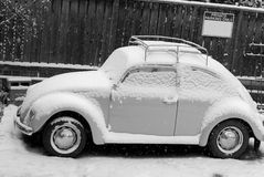 Bug under Snow. A classic car sits under a fresh blanket of snow Royalty Free Stock Photos