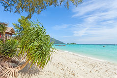 Bugalow by a pristine beach, summer paradise background. Stock Image