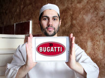 Bugatti car logo. Logo of Bugatti car brand on samsung tablet holded by arab muslim man Stock Image