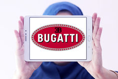 Bugatti car logo. Logo of Bugatti car brand on samsung tablet holded by arab muslim woman Royalty Free Stock Images