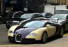 Bugatti car on London streets. Bugatti Veyron 2014 on Park Lane,the City of Westminster,  Central London UK Royalty Free Stock Photography