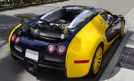 Bugatti closeup on road. Stylish Bugatti car on Rodeo Drive in Beverly Hills, California. Image taken as a closeup from backside. The luxury car is painted in Royalty Free Stock Photo