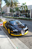 Bugatti on Rodeo Drive. A yellow brown Bugatti on Rodeo Drive in Beverly Hills California Stock Photo