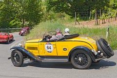 Bugatti T 40 (1930)  in Mille Miglia 2014. The crew Frascari - Teneggi on ancient sports car Bugatti T 40 (1930) runs in italian historical race Mille Miglia, on Royalty Free Stock Photography