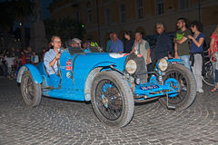Bugatti  T 37  (1926) in Mille Miglia 2015. Drivers on ancient Italian car Bugatti  T 37  (1926) traveling at night in italian historic race for classic cars Stock Images