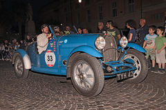 Bugatti T40 (1927) in Mille Miglia 2015. Drivers on an old Italian car Bugatti T40 (1927) traveling at night in italian historic race for classic cars Mille Stock Photos