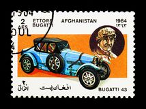 Bugatti Type 43 Sports car (1927) and Ettore Bugatti, Motor cars. MOSCOW, RUSSIA - DECEMBER 21, 2017: A stamp printed in Afghanistan shows Bugatti Type 43 Sports Stock Photos