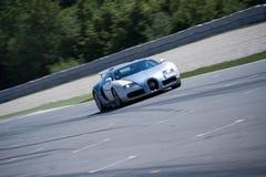 Bugatti Veyron on circuit driving thru stock images