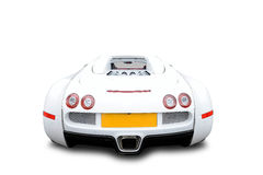 Bugatti Veyron sports car. White Bugatti Veyron luxury sports car from behind on white background Royalty Free Stock Photos