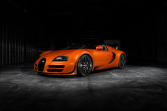 Bugatti Veyron Vitesse. An orange Bugatti Veyron Vitesse shot in a dark warehouse Royalty Free Stock Photos