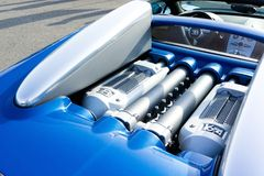 Bugatti W16 engine. Blue Bugatti W16 engine on race track.This is very high power 1000ps engine Stock Photography