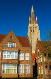 Bruges architecture - the Church of Our Lady tower. The Church of Our Lady tower and red tiled roofs in Bruges Royalty Free Stock Images