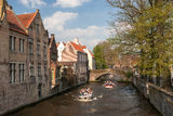 Bruges architecture - old canal with boats. The fence with old buildings in Bruges Royalty Free Stock Images