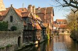 Bruges architecture - old canals. The canal with old buildings in Bruges Stock Photo