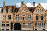 Bruges architecture - old houses. The jaxtoposition of acient building and modern car Royalty Free Stock Photos