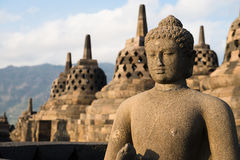 Buggha statue and stupas in Borobudur temple, Indonesia. Buddha statue and stupas in Borobudur, or Barabudur, temple Jogjakarta, Java, Indonesia. It is a 9th Stock Images
