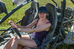 Buggy car at green field. Young woman driving, Almaty, Kazakhsta. N Royalty Free Stock Images