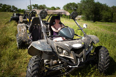 Buggy car at green field. Young woman driving, Almaty, Kazakhsta. N Stock Image