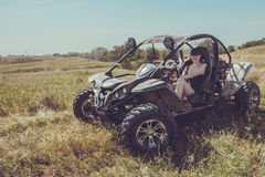 Buggy car at green field. Young woman driving, Almaty, Kazakhsta. N Royalty Free Stock Photos