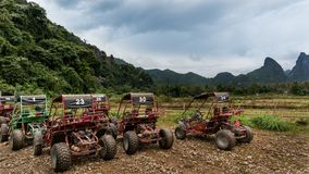 Buggy Gang. Buggy car parking in Vang Vieng alley, surround by nature Royalty Free Stock Photos