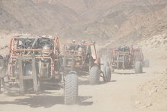 Buggy in the convoy traveling through the desert Stock Photography