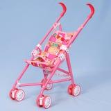 Buggy de bebê do brinquedo fotografia de stock royalty free