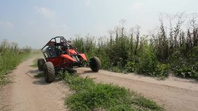 Buggy rides on the ground road stock video footage