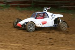Buggy on track going fast and throwing dirt in the air Royalty Free Stock Images