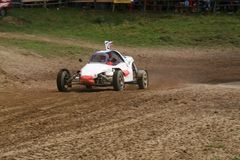 Buggy on track going fast and throwing dirt in the air Stock Photography