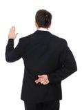 Bugiardo dell'uomo di affari Immagini Stock