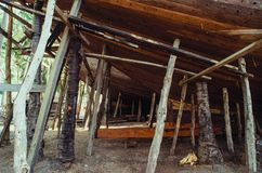 Traditional boat building in South Sulawesi, Indonesia. The Buginese people are an ethnic group, wellknown for there craftsmanship in building ocean-going barges stock photography