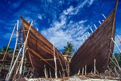 Traditional boat building in South Sulawesi, Indonesia. The Buginese people are an ethnic group, wellknown for there craftsmanship in building ocean-going barges stock photos