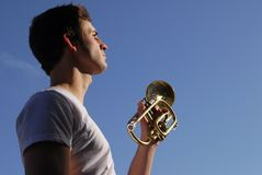 Bugle Boy. A soldier about to play revelry Stock Photography