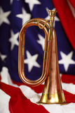 Bugle with flag. Bright brass and copper bugle with US flag Stock Photography