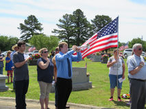 Bugler plays taps, Sallisaw City Cemetery, Memorial Day, May 29, 2017. Young man plays taps on a bugle on Memorial Day. Sallisaw City Cemetery, Sallisaw Royalty Free Stock Photos
