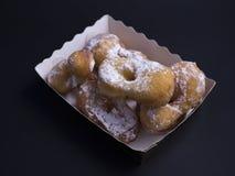 Bugnes, французский тип печенье донута покрытое с напудренным сахаром Стоковая Фотография