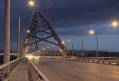 On the Bugrinsky bridge with burning lights stock image