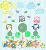 Buhos que se sientan en el árbol y las flores Foto de archivo