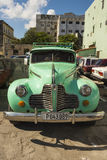 Buick 1940s Havana. Mint green Buick 1940s on parking lot in Havana, Cuba Royalty Free Stock Photography
