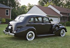 Buick Sedan - Vintage. A Black Vintage Buick parked out in front lawn. 1930's - No emblems visable stock photos