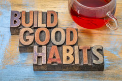 Buid good habits motivational concept. Build good habits motivational concept - text in vintage letterpress wood type with a cup of tea Royalty Free Stock Photos