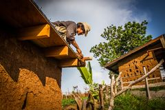 Mud house roof making Royalty Free Stock Photo