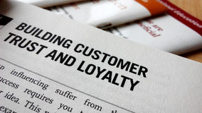 Buiding customer trust and loyalty word on a book Royalty Free Stock Photos