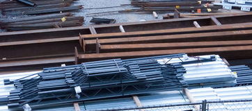 Buiding Materials For Consturction. Beams, trusses and reinfocing steel rods laying in wait for use in a storage area at a new building site Stock Photo
