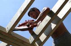Buiding the Roof. A constuction worker builds a roof royalty free stock images