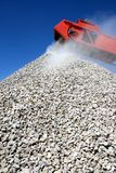 Buiding Stone and Conveyor. Conveyor and pile of quarry stone for building sorted according to size royalty free stock photos