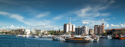 Buidings and boats on Canakkale shore. A panorama of the small harbor and the seafront in Canakkale City in Turkey on a sunny day Royalty Free Stock Images