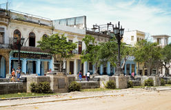 Buidings and people on Prado in Havana. Young people strolling on Prado in Havana Royalty Free Stock Photo