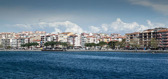 Buidings and seafront in Turkey. A panorama of the seafront and buildings in Canakkale City in Turkey on a sunny day Royalty Free Stock Photos